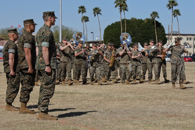 U.S. Marines participate in the Marine Air Control Squadron 1 Relief and Appointment ceremony at Marine Corps Air Station Yuma, Ariz., March 13, 2019. The Relief and Appointment ceremony is an honored product of the rich heritage of Naval tradition. The heart of the ceremony is the passing of the organizational Non-commissioned officer Sword by the Activity Commander from the outgoing Sergeant Major to the new Sergeant Major, which signifies the transfer of responsibility, accountability and authority, from one individual to another. (U.S. Marine Corps photo by Lance Cpl. Joel Soriano)