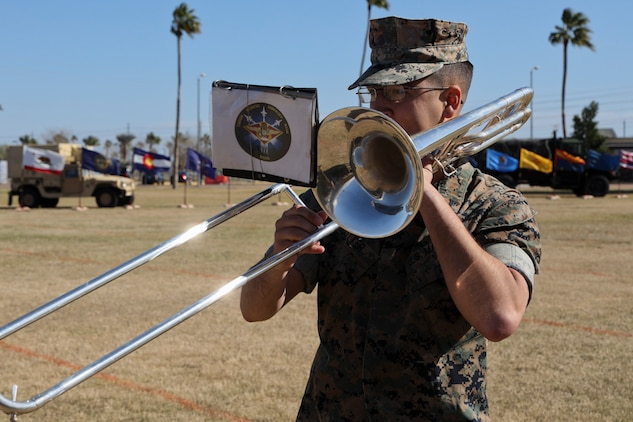 A U.S. Marine assigned to the 3rd Marine Aircraft Wing Band plays his instrument before the Marine Air Control Squadron 1 Relief and Appointment Ceremony at Marine Corps Air Station Yuma, Ariz., March 13, 2019.The Relief and Appointment ceremony is an honored product of the rich heritage of Naval tradition. The heart of the ceremony is the passing of the organizational Non-Commissioned Officer (NCO) Sword by the Activity Commander from the outgoing Sergeant Major to the new Sergeant Major, which signifies the transfer of responsibility, accountability and authority, from one individual to another. (U.S. Marine Corps photo by Lance Cpl. Joel Soriano)