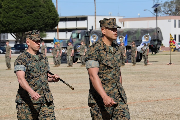 U.S. Marine Corps Sgt. Maj. William Bilenski (Left) and Sgt. Maj. George Hernandez (Right) prepare to exchange the Non-Commissioned Officer (NCO) Sword during the Marine Air Control Squadron 1 Relief and Appointment ceremony at Marine Corps Air Station Yuma, Ariz., March 13, 2019. The Relief and Appointment ceremony is an honored product of the rich heritage of Naval tradition. The heart of the ceremony is the passing of the organizational Non-Commissioned Officer (NCO) Sword by the Activity Commander from the outgoing Sergeant Major to the new Sergeant Major, which signifies the transfer of responsibility, accountability and authority, from one individual to another. (U.S. Marine Corps photo by Lance Cpl. Joel Soriano)