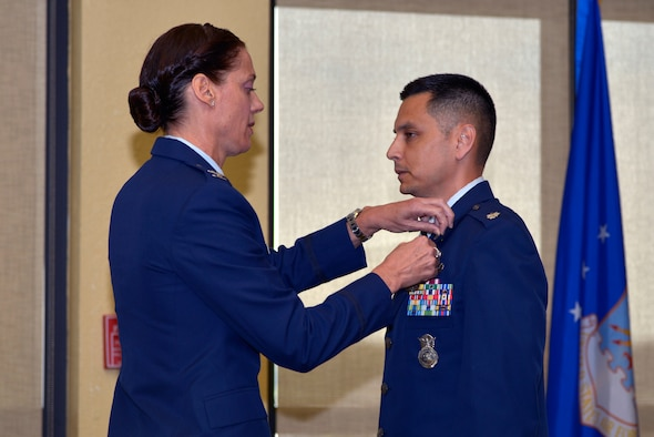 U.S. Air Force Col. Marcia L. Quigley, 81st Mission Support Group commander, presents the Meritorious Service medal to Lt. Col. Jonathon M. Murray, outgoing 81st Security Forces Squadron commander, during the 81st SFS change of command ceremony inside the Bay Breeze Event Center at Keesler Air Force Base, Mississippi, May 31, 2019. Maj. Matthew Lowe, incoming 81st SFS commander, assumed command from Murray with the passing of the guidon. The passing of the guidon is a ceremonial symbol of exchanging command from one commander to another. (U.S. Air Force photo by Airman Seth Haddix)