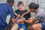 Air Advisors from the 571st Mobility Support Advisory Squadron and partner nation students participate in a medical exercise using moulaged patients during a mobile training team mission in Belize. The 571st MSAS conducted a first-ever air, land and sea training mission with the Belize Air Wing, Belize Defence Force, and Belize Coast Guard from May 3 -18. (Courtesy photo)