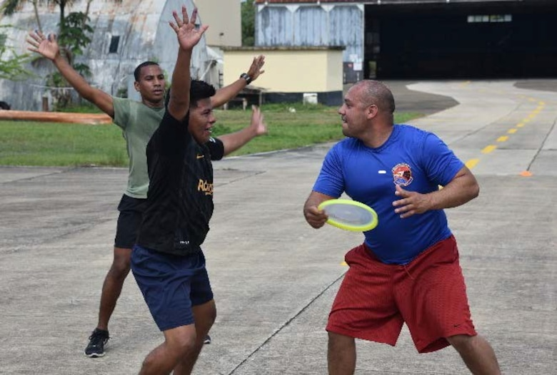 Tech. Sgt. Jose Arroyo, 571st Mobility Support Advisory Squadron air advisor, right, plays a friendly game of ultimate frisbee with partner nation students during a mobile training team mission in Belize. The 571st MSAS conducted a first-ever air, land and sea training mission with the Belize Air Wing, Belize Defence Force, and Belize Coast Guard from May 3 -18. (Courtesy photo)