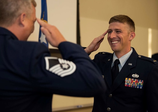 Master Sgt. Bryan Patterson, 157th Fighter Squadron Aerospace Control Alert Crew Leader, salutes 2nd Lt. Nicholas Forester, University of Nevada, Las Vegas (UNLV) Reserve Officer Training Corps (ROTC) graduate, at the Hospitality building on UNLV campus, Nev., May 24, 2019. Forester was previously an F-16 Fighting Falcon fighter jet tactical aircraft maintainer at     McEntire Joint National Guard Base, S.C., Osan Air Base, South Korea and Nellis Air Force Base, Nev. From 2009 to 2015. (U.S. Air Force illustration by Airman 1st Class Bryan Guthrie)