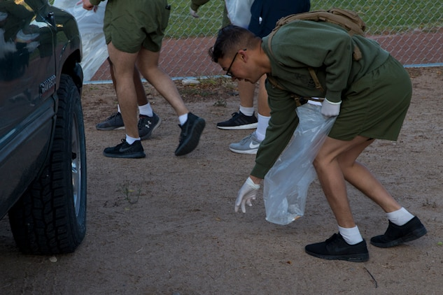U.S. Marines with Headquaters and Headquarters Squadron(H&HS) conduct a base wide clean up at Marine Corps Air Station(MCAS) Yuma, Ariz., March 15, 2019. The base clean up is intended to boost unit morale and ensure the cleanliness of MCAS Yuma. (U.S. Marine Corps photo by Pfc John Hall)