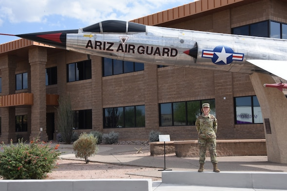Chief Master Sgt. Rachel Landegent, 161st Air Refueling Wing mission support group superintendent, poses in front of a static display at her duty station June 2, 2019. Landegent is the 2019 Air National Guard First Sergeant of the Year, never faltering in her duty-bound mission to inspire Airman to rise beyond limits. (U.S. Air National Guard photo by 1st Lt. Tinashe Machona)