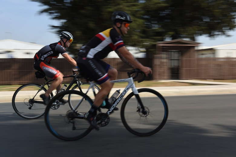Staff Sgt. Chase Kelly, 39th Operations Support Squadron air traffic controller watch supervisor, left, and Master Sgt. Jonathan Wyatt, 39th Operations Support Squadron NCO in charge of air traffic control standardization and evaluation, right, ride their bikes June 1, 2019, at Incirlik Air Base, Turkey. The pair are part of a bike group, which is designed to help Airmen decrease stress levels and build morale. (U.S. Air Force photo by Staff Sgt. Matthew J. Wisher)