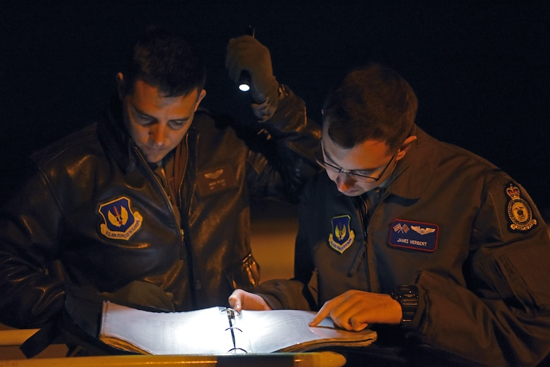 U.S. Air Force Capt. Vincent Pellegri, 351st Air Refueling Squadron aircraft commander, and 1st Lt. James Herbert, 351st ARS pilot, look over flight plans prior to takeoff during exercise Astral Knight at RAF Mildenhall, England, June 3, 2019. AK19 is a joint, multinational exercise which aims to demonstrate the integration, coordination, and interoperability of joint existing command and control at the operation and tactical levels. (U.S. Air Force photo by Airman 1st Class Brandon Esau)