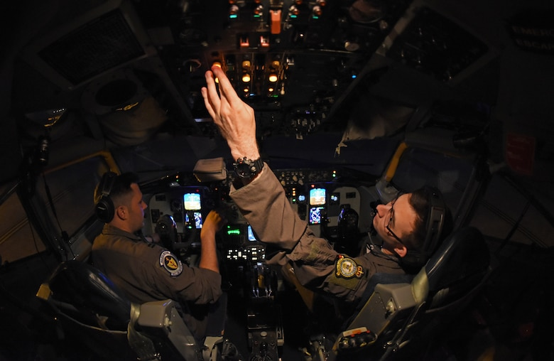 U.S. Air Force 1st Lt. James Herbert, 351st Air Refueling Squadron, performs pre-flight checks during exercise Astral Knight at RAF Mildenhall, England, June 3, 2019. AK19 is a joint, multinational exercise which aims to demonstrate the integration, coordination, and interoperability of joint existing command and control at the operation and tactical levels. (U.S. Air Force photo by Airman 1st Class Brandon Esau)