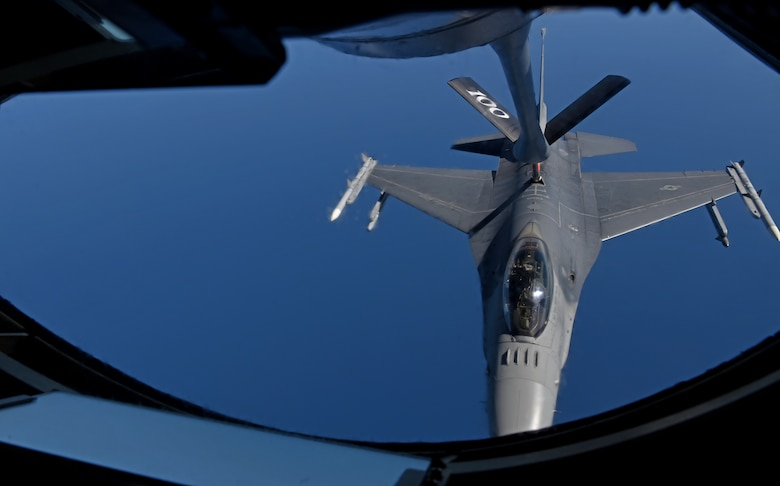 A U.S. Air Force F-16 Fighting Falcon from the 457th Fighter Squadron, Fort Worth, TX,  prepares to receive fuel from a 100th Air Refueling Wing KC-135 Stratotanker from RAF Mildenhall, England, during exercise Astral Knight over the skies of Italy, June 3, 2019. AK19 is a joint, multinational exercise which aims to demonstrate the integration, coordination, and interoperability of joint existing command and control at the operation and tactical levels. (U.S. Air Force photo by Airman 1st Class Brandon Esau)