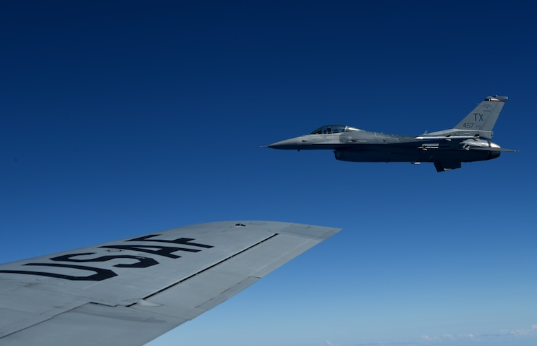 A U.S. Air Force F-16 Fighting Falcon from the 457th Fighter Squadron, Fort Worth, TX,  flies in formation alongside a 100th Air Refueling Wing KC-135 Stratotanker from RAF Mildenhall, England, during exercise Astral Knight over the skies of Italy, June 3, 2019. AK19 is a joint, multinational exercise which aims to demonstrate the integration, coordination, and interoperability of joint existing command and control at the operation and tactical levels. (U.S. Air Force photo by Airman 1st Class Brandon Esau)