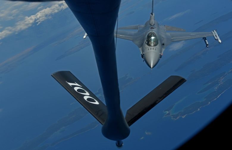 A U.S. Air Force F-16 Fighting Falcon from the 457th Fighter Squadron, Fort Worth, Texas, prepares to receive fuel from a 100th Air Refueling Wing KC-135 Stratotanker from RAF Mildenhall, England, during exercise Astral Knight over the skies of Italy, June 3, 2019. AK19 is a joint, multinational exercise designed to test Integrated Air and Missile Defense capabilities and will involve a combination of flight operations and computer-assisted exercise scenarios. Participants include the U.S. Air Forces in Europe, U.S. Army Europe forces, and members from the Italian and Croatian air forces. (U.S. Air Force photo by Airman 1st Class Brandon Esau)