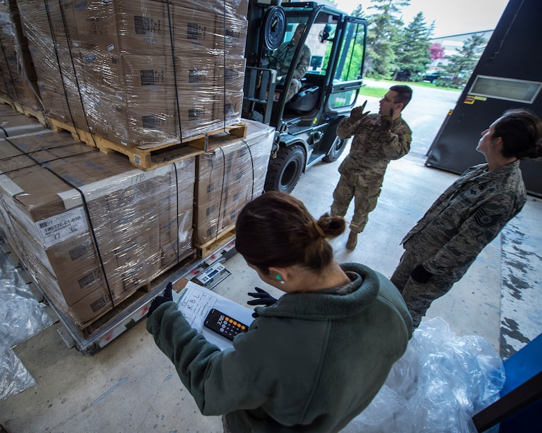 U.S. Air Force Airmen with the 133rd Small Air Terminal load boxes of food onto pallets in St. Paul, May 18, 2019.