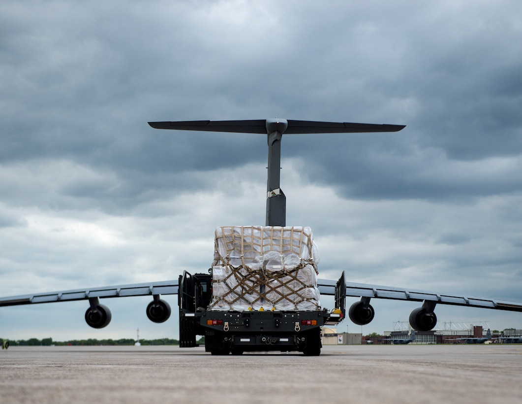 A 60K Loader from the 133rd Small Air Terminal waits to off load the cargo onto a C-5 Galaxy in St. Paul, Minn., May 22, 2019.