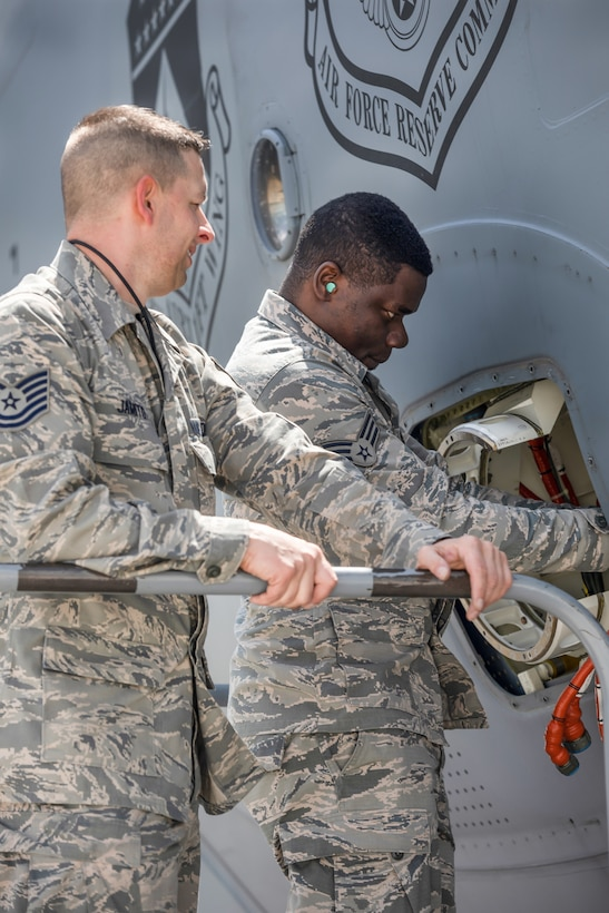 Tech. Sgt. Jeremie Jamito and Senior Airman Nuren Subair, both from the 445th Aircraft Maintenance Squadron, make repairs on a C-17 Globemaster III here, May 5, 2019.  (U.S. Air Force photo /Master Sgt. Patrick O'Reilly)