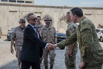 Ambassadors of different nations are greeted by members of the Combined Joint Task Force- Operation Inherent Resolve (CJTF-OIR) on Ambassador's Day on Union 3, Iraq, June 4, 2019. Key members of CJTF-OIR arranged the day in order to talk to ambassador's of the coalition's nations on the progress of the partnership established by CJTF-OIR and the population of Iraq. The Coalition continually reviews its force levels in Iraq in order to achieve the job that has been requested of us by the Government of Iraq. (Portions of this image have been blurred to protect operational security) (U.S Army Photo by Spc. Adrian Pacheco)