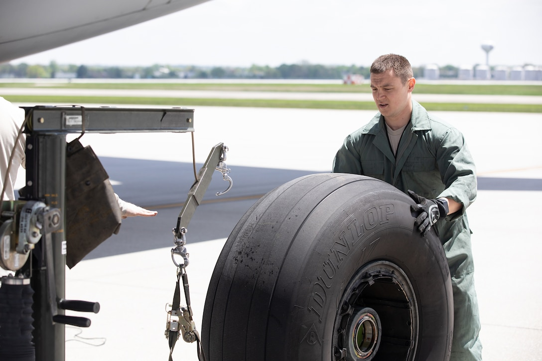 Staff Sgt. Brian Wylie, 445th Aircraft Maintenance Squadron, replaces a tire on a C-17 Globemaster III here, May 5, 2019.  (U.S. Air Force photo /Master Sgt. Patrick O'Reilly