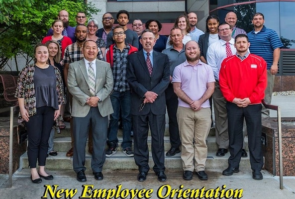 Group photo of 22 new employees with Mr. Warren for the May 2019 NEO.