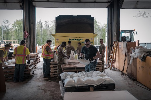 Service members assigned to the New York Army National Guard and New York Naval Militia, along with employees from the Department of Transportation, fill sandbags at Sodus Point, N.Y., May 20, 2019. The sandbags are being used to mitigate the effects of flooding along Lake Ontario as a result of rising water levels, that followed up with the activation of the troops by Gov. Andrew Cuomo.