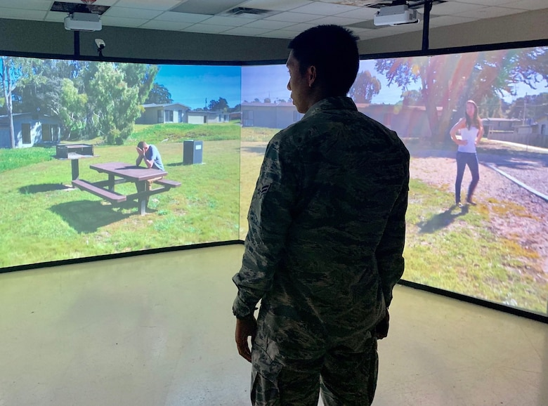 Airman 1st Class Valric Suyom, a recent graduate of the Security Forces apprentice course, participates in a use of force training scenario in the Multiple Interactive Learning Objectives, or MILO, simulator at Joint Base San Antonio-Lackland May 29. The 343rd Training Squadron has six MILO systems in place at the JBSA-Lackland Medina Annex training campus, including two 180-degree video theater systems, as well as four single-screen systems.