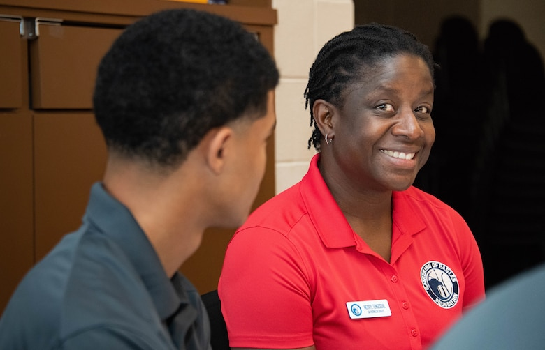 """Retired Col. Merryl """"Dragon Lady"""" Tengesdal, chats with students, May 28, 2019, on Maxwell Air Force Base, Alabama. Tengesdal was invited to an Eagle for the 38th annual Gathering of Eagles due to her distinguished career as a U-2 high-altitude reconnaissance aircraft command pilot, with more than 3,400 flight hours and 330 command hours. She was the first and only African American woman to fly the U-2 and one of only five women and three African Americans to be accepted into the U-2 program."""