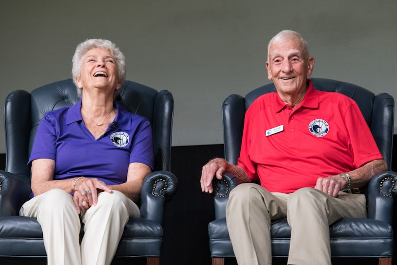 "Retired Col. Carlyle ""Smitty"" Harris, and his wife, speak with Air Command and Staff College students, May 29, 2019, during the 38th annual Gathering of Eagles at Maxwell Air Force Base, Alabama. Harris was selected as an Eagle for his acts of leadership and courage during his time as a POW in Vietnam, where he introduced the tap code as a means for prisoners to communicate."