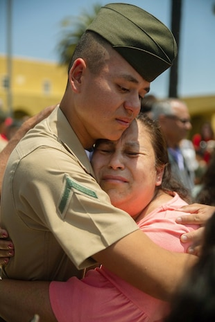 The new Marines of Alpha Company, 1st Recruit Training Battalion, reunite with their loved ones during Family Day at Marine Corps Recruit Depot San Diego, May 30.