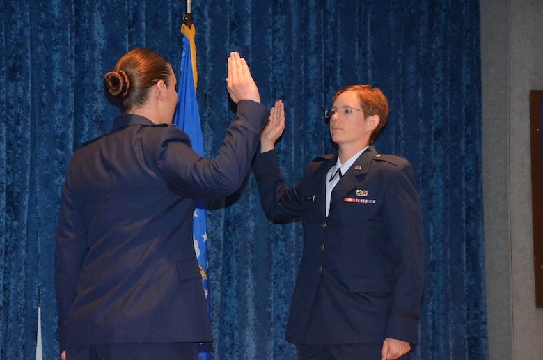 1st Lt. Ashley M. Dalessandro (left) administers the commissioning oath to Officer Trainee Cynthia A. Schroll during a ceremony at Maxwell Air Force Base, Ala.  Schroll, a former E-3 with a doctorate in analytical chemistry, joined the officer ranks after completing Air Force Officer Training School May 31, 2019.  (U.S. Air Force photo by Susan A. Romano)