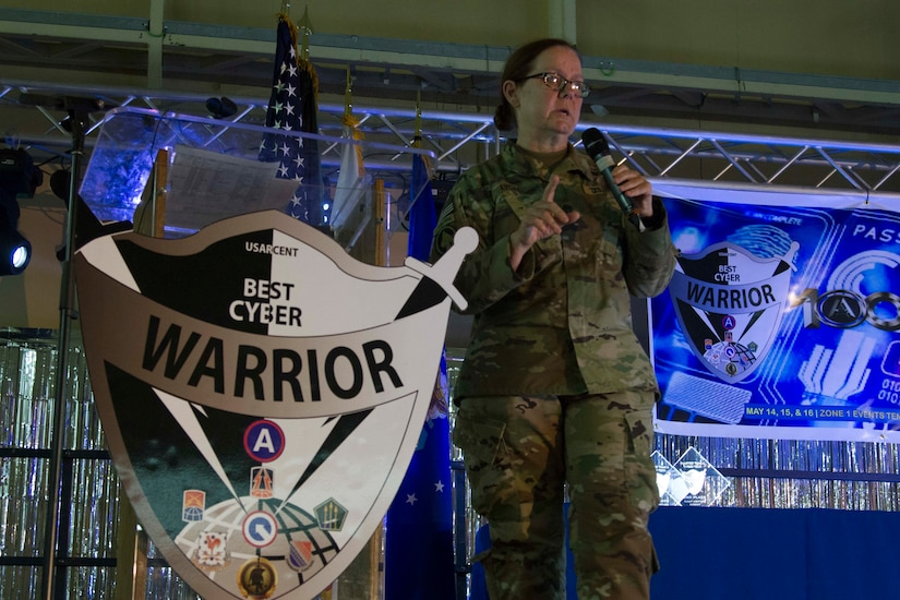 Command Sgt. Maj. Sheryl Lyon, senior enlisted advisor for U.S. Army Cyber Command, speaks to participants about the importance of cyber security during the 2019 Best Cyber Warrior Competition at Camp Arifjan, Kuwait, May 16, 2019. The event was conducted to increase the culture of cybersecurity awareness and understanding at all echelons, reduce risk, and protect Army, Department of Defense, and personal networks through hosting an interactive learning experience in both a fun and competitive environment.