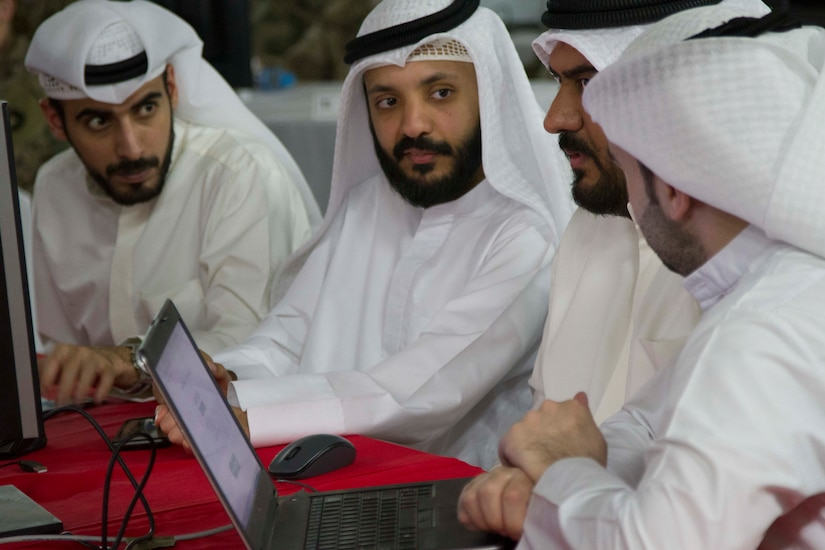 From left, Ali Al Hamad, Dhari Al Shalahi, Eisa Alazmi, and Abdullah Awad, all part of Communication and Information Technology Regulatory Authority (CITRA), work together while participating in the 2019 Best Cyber Warrior Competition at Camp Arifjan, Kuwait, May 16, 2019. United States Army Central approved 335th Signal Battalion (Theater) (Provisional) to host the Best Cyber Warrior Competition to challenge the cyber skills of service members and host nation allies while strengthening the bond of its foreign partners.
