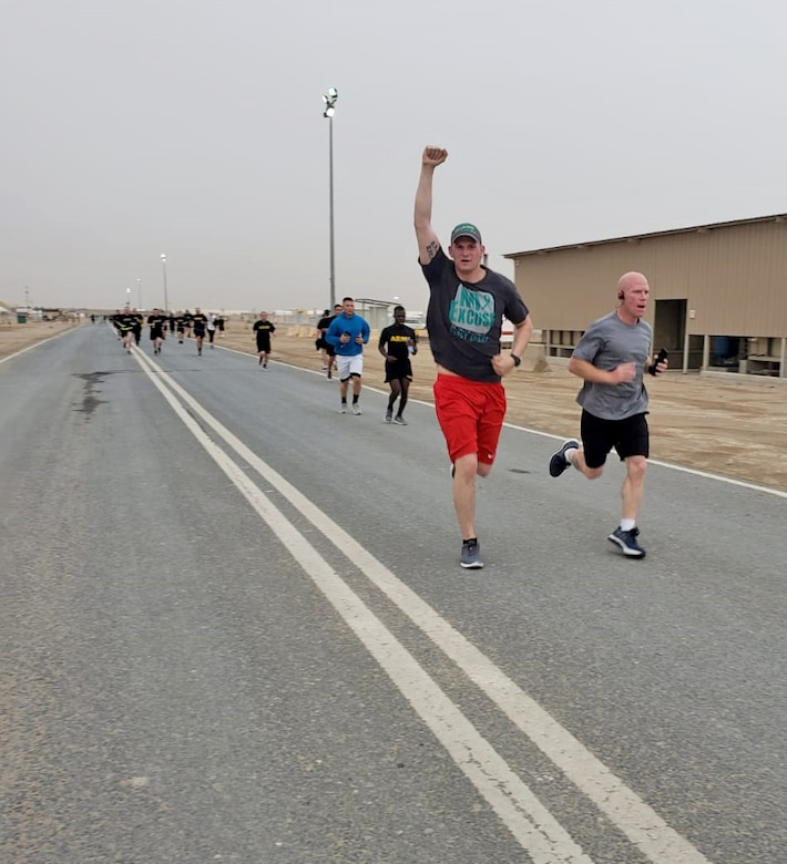 Staff Sgt. Joel Conrad, the 3rd Armored Brigade Combat Team, 4th Infantry Division Victim Advocate, shows off his Sexual Harassment and Assault Response and Prevention (SHARP) pride during a SHARP 5k race at Camp Buehring, Kuwait in Aprill 2019. As Victim Advocate, Conrad is a major part of coordinating activities and training to ensure Iron Brigade Soldiers are informed about sexual harassment and assault response and prevention.