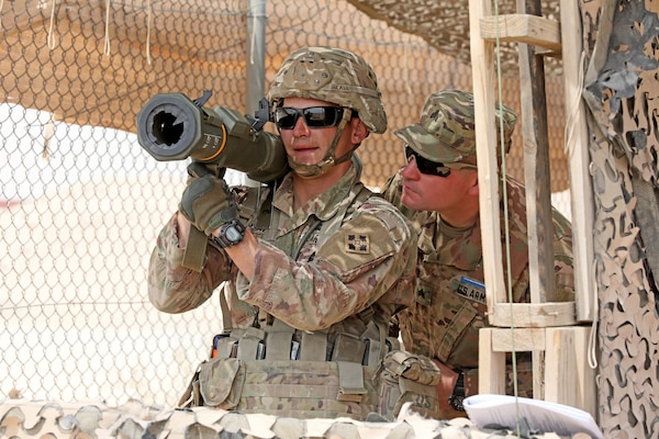 Sgt. Jared Beall, an infantry Soldier with 1st Battalion, 68th Armor Regiment, 3rd Armored Brigade Combat Team, 4th Infantry Division, undergoes evaluation on the M136 AT4 anti-tank weapon during testing for the Expert Infantryman Badge at Camp Buehring, Kuwait on Wednesday, May 29, 2019. During weapons, medical, and patrol lanes, Soldiers tested at 10 stations each day, demonstrating expertise in a variety of skills and tasks.