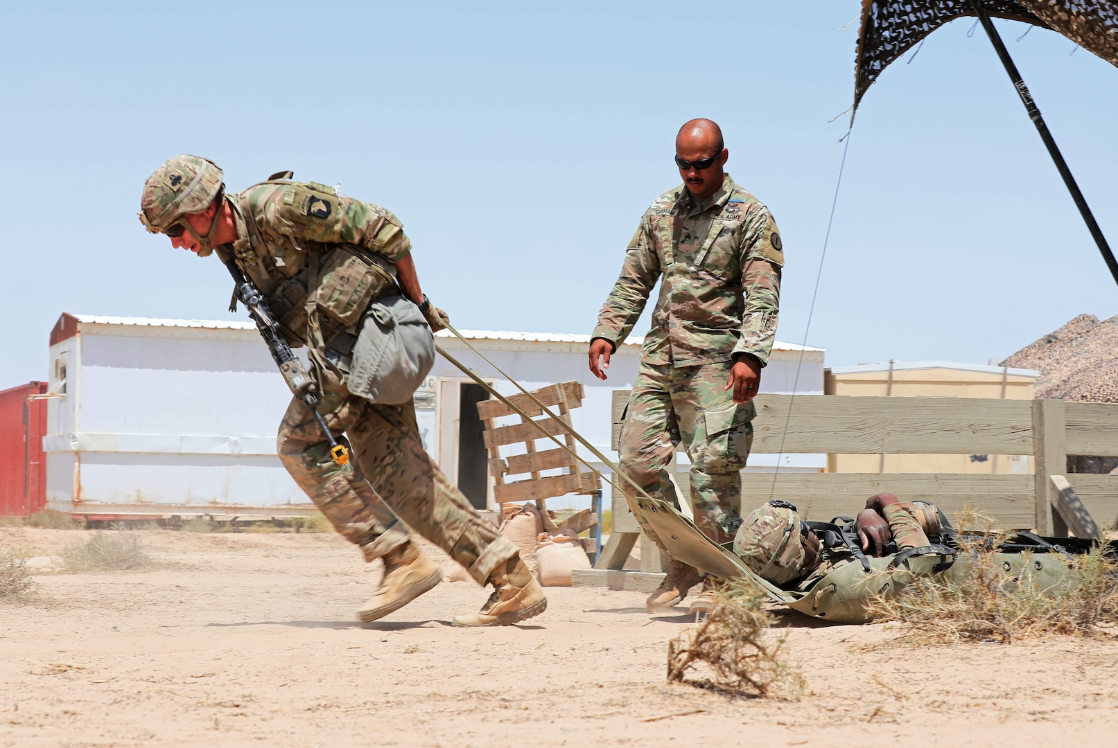 Staff Sgt. David Schwigen, an infantry Soldier with 1st Battalion, 327th Infantry Regiment, 1st Brigade Combat Team, 101st Infantry Division, moves a simulated casualty 50 meters to a casualty collection point during Expert Infantryman Badge testing at Camp Buehring, Kuwait on Thursday, May 30, 2019. Infantry Soldiers throughout the U.S. Army Central area of operations were invited to participate in EIB testing hosted by the 3rd Armored Brigade Combat Team, 4th Infantry Division.