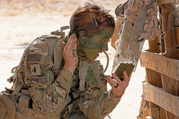 1st Lt. Shelby DePriest, an infantry Soldier with 1st Battalion, 8th Infantry Regiment, 3rd Armored Brigade Combat Team, 4th Infantry Division, applies camouflage face paint during patrol lane testing for the Expert Infantryman Badge at Camp Buehring, Kuwait on Friday, May 31, 2019. Upon completion of testing, DePriest became the first female EIB awardee in the 4th Infantry Division.