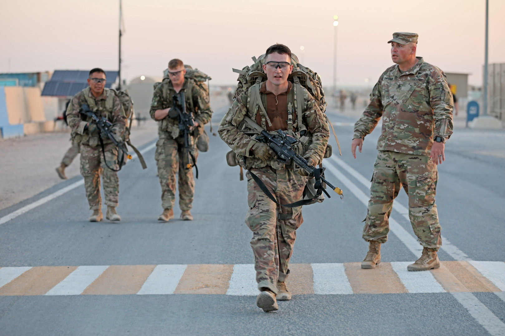 Infantry Soldiers deployed in the U.S. Army Central area of operations finish a 12-mile ruck march in less than three hours as the final event in Expert Infantryman Badge testing at Camp Buehring, Kuwait on Saturday, June 1, 2019. The ruck march, in addition to a final weapons test and gear layout, concluded a week-long testing event in which 61 infantry Soldiers earned their EIB.