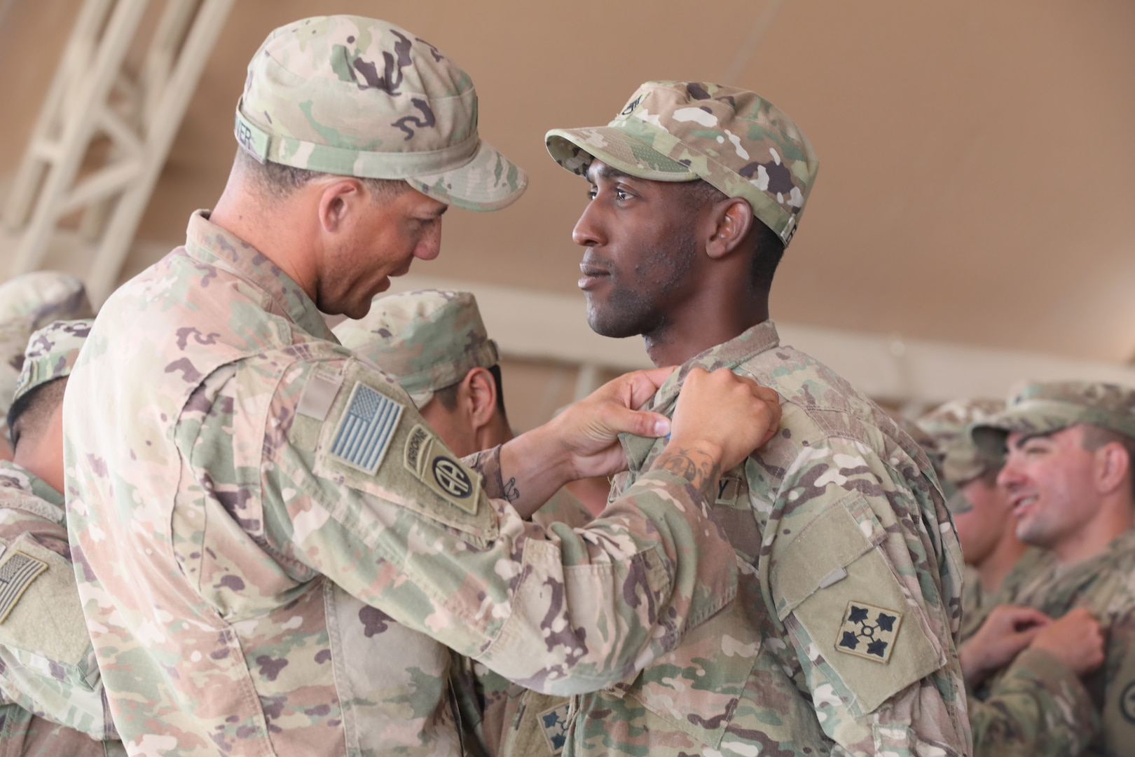 Staff Sgt. Stephen Frazier, an infantryman in 1st Battalion, 66th Armor Regiment, 3rd Armored Brigade Combat Team, 4th Infantry Division, is pinned with an Expert Infantryman Badge during a ceremony at Camp Buehring, Kuwait on Saturday, June 1, 2019. Frazier and 60 other infantry Soldiers deployed throughout the U.S. Army Central area of operations earned their EIB after completing a week of thorough testing with 3rd ABCT at Camp Buehring.