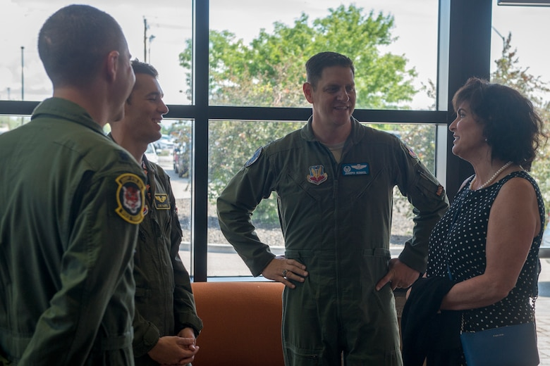 """From left: Lt. Col. Travis Stephens, 391st Fighter Squadron commander, 1st Lt. James Harris, 391st FS weapons systems officer, Col. Joe Kunkel, 366th Fighter Wing commander, and Janine Sijan-Rozina, Capt. Lance P. Sijan's sister, meet at the 391st FS building May 30, 2019 at Mountain Home Air Force Base, Idaho. Sijan-Rozina visited several locations on base during the two-day MHAFB premiere of the documentary """"SIJAN"""" and spoke to next-generation Gunfighters about her brother's story. (U.S Air Force photo by Airman 1st Class JaNae Capuno)"""