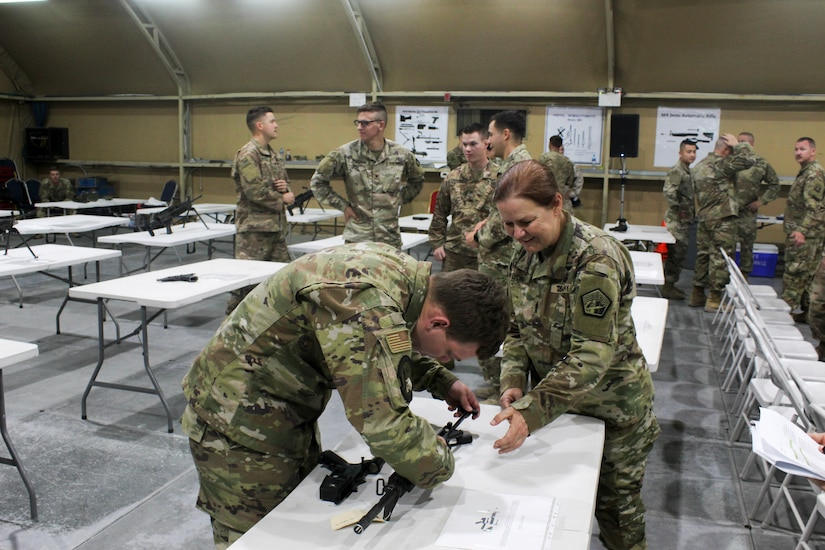 Command Sgt. Maj. Sheryl Lyon, U.S. Army Cyber Command senior enlisted leader, coaches U.S. Air Force Staff Sgt. Shaun Trainor, a client systems technician for the 386th Expeditionary Communications Squadron, on the assembly of the M4 carbine during the U.S. Army Central  2019 Best Cyber Warrior Competition, at Camp Arifjan, Kuwait, May 14, 2019. The event was the first joint, multinational competition, and highlighted the teamwork required to defend the U.S. in the cyber domain.