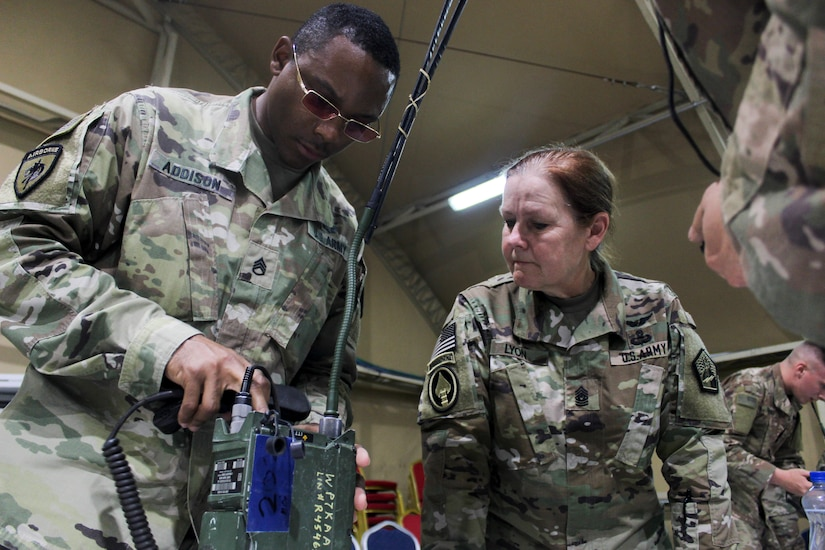 Command Sgt. Maj. Sheryl Lyon, U.S. Army Cyber Command senior enlisted leader, observes as Staff Sgt. Sir Addison, network management NCO-in-charge for the Regional Cyber Center-Southwest Asia (RCC-SWA), assembles and operates a radio as part of the U.S. Army Central  2019 Best Cyber Warrior Competition, at Camp Arifjan, Kuwait, May 14, 2019 .  The three-day, joint, multinational competition, highlighted the readiness and teamwork of the forces defending the U.S. in the cyber domain.