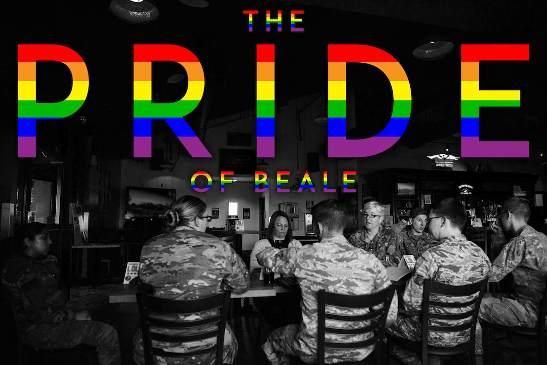 """Multiple members of Beale's LGBTQ group are gathered around a table with the graphic rainbow colored letters above them saying """"The Pride of Beale."""""""