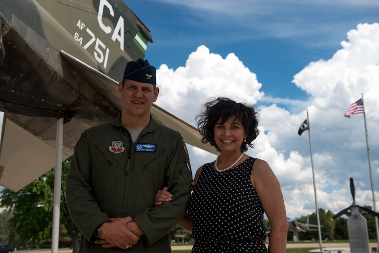 """Col. Joe Kunkel, 366th Fighter Wing commander and Janine Sijan-Rozina, Capt. Lance P. Sijan's sister, visit the Capt. Lance P. Sijan memorial at Holt Park, May 30th 2019 at Mountain Home Air Force Base, Idaho. Sijan-Rozina visited several locations on base during the two-day MHAFB premiere of the documentary """"SIJAN"""" and spoke to next-generation Gunfighters about her brother's story. (U.S Air Force photo by Airman 1st Class JaNae Capuno)"""