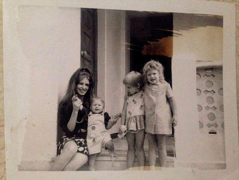 Joseph Green on the steps of his home with his mother and sisters in Zahra, Tunisia around 1971.