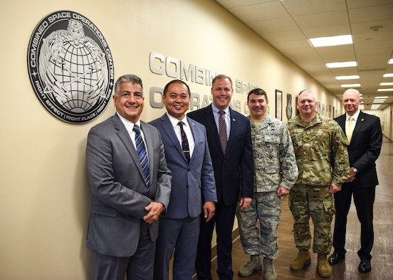 Jim Bridenstine, NASA administrator and Brig. Gen. Matthew Davidson, 14th Air Force vice commander, pose for a photo with senior space officials at the Combined Space Operations Center during a visit June 3, 2019, at Vandenberg Air Force Base, Calif.  During the visit Bridenstine met with officials from the CSpOC, 18th Space Control Squadron, Commercial Integration Cell, Joint Force Space Component Command and SpaceX to discuss space operations and support. The CSpOC actively supports human space flight operations and safety for NASA and astronauts aboard the International Space Station. (U.S. Air Force photo by Airman 1st Class Aubree Milks)