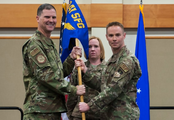 Maj. Brian Gilliam, right, accepts command of the 741st Missile Security Forces Squadron from Col. Aaron Guill, 341st Security Forces Group commander during a change of command ceremony June 4, 2019, at the Grizzly Bend on Malmstrom Air Force Base, Mont