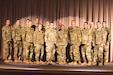 Eighteen Soldiers from the 174th Cyber Protection Team stand on the stage of the Utah National Guard's Draper headquarters during their departure ceremony Jan. 2, 2019.