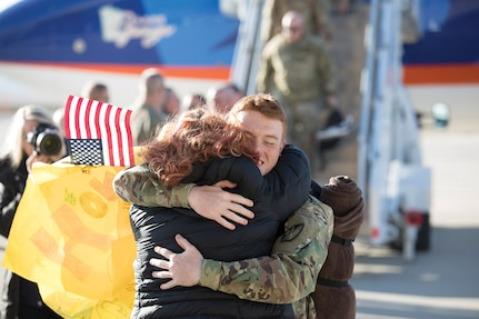 Members of the 65th Field Artillery greet the awaiting crowd upon their return from a Middle East deployment Jan 31 to the Rolland R. Wright Air Base, Salt Lake City.