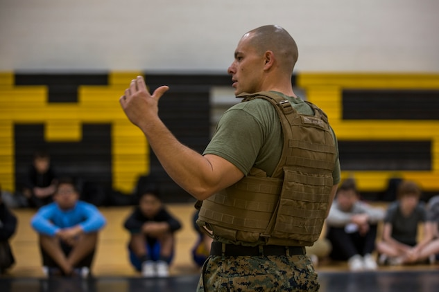 U.S. Marines assigned to Marine Air Control Squadron (MACS) 1 participate in MACS-1's Marine Week at Ron Watson Middle School in Yuma, Ariz., March 27, 2019. The first day of Marine Week consisted of opening remarks from the MACS-1 Commanding Officer, Lt. Col. David Hughes, and demonstrations of the Marine Corps Martial Arts Program (MCMAP) techniques. (U.S. Marine Corps photo by Cpl. Sabrina Candiaflores)