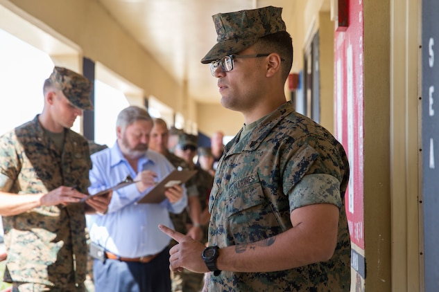 "U.S. Marines assigned to Headquarters & Headquarters Squadron (H&HS) participate in a barracks deck competition at the Marine Corps Air Station (MCAS) Yuma H&HS Barracks, March 28, 2019. The Marines had 72 hours to paint and design their deck how they pleased, with rules and guidelines to adhere to. Third deck won the competition with a theme of ""Operation Enduring Freedom"". (U.S. Marine Corps photo by Cpl. Sabrina Candiaflores)"
