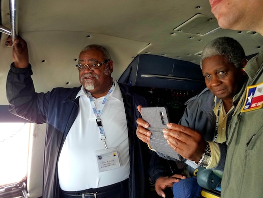 Jerry W. Dailey (left), Macedonia Baptist senior pastor and the Rev. Ruben Archield, Friendship Baptist Church, observe the south Texas landscape from the cockpit of a C-5M Super Galaxy.
