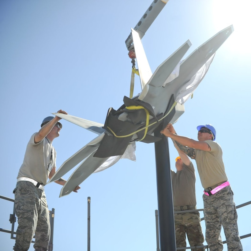 The sculptures represents the schoolhouse for raptor pilot training and are a symbol of Air Dominance.