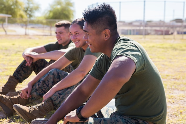 U.S. Marines assigned to Marine Air Control Squadron (MACS) 1 participate in MACS-1's Marine Week at Ron Watson Middle School in Yuma, Ariz., March 29, 2019. The third and last day of Marine Week consisted of students conducting a modified Combat Fitness Test, tasting food from Meal, Ready-to-Eat (MRE), trying on Marine Corps equipment; flak jackets, gas masks, etc., and interacting with the Marines. (U.S. Marine Corps photo by Cpl. Sabrina Candiaflores)